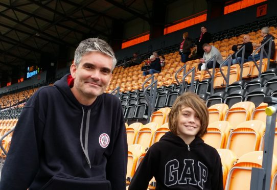 Mat Guy with his nephew, who accompanied him to a few games during his northern travels.