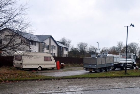 Travellers have set up in a car park at the Rohaan Cafe off Burnside Drive Dyce. Picture by Chris Sumner