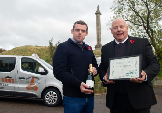 Moray MP Douglas Ross and taxi driver Garey Stewart.