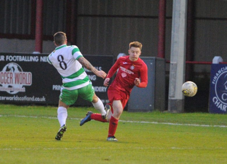 Broras Andrew Macrae is fouled by Buckie 8 Jay Cheyne resulting in a sending off. Picture by JASON HEDGES