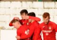 First Goal by Jordan Macrae from a penalty and Brora celebrate  Pictures by JASON HEDGES