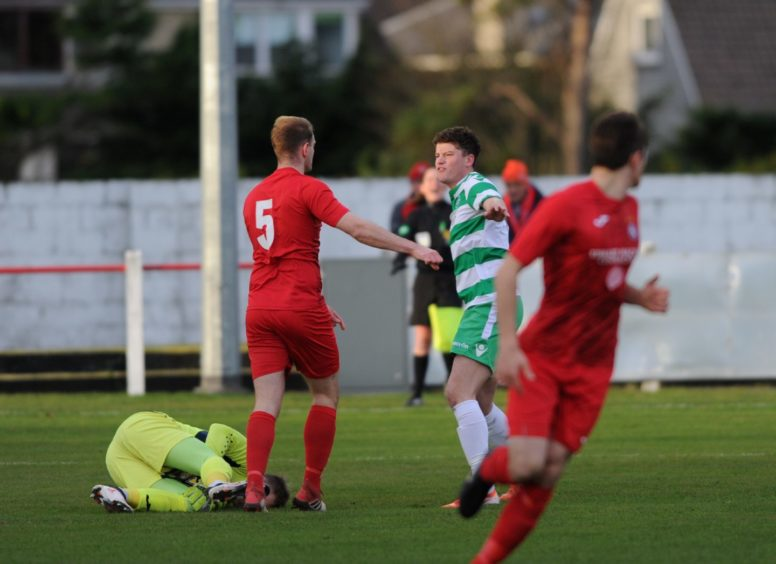 Tempers fly between Broras Mark Nicholson and Buckie's Sam Robertson resulting in a booking for Buckie  Picture by JASON HEDGES