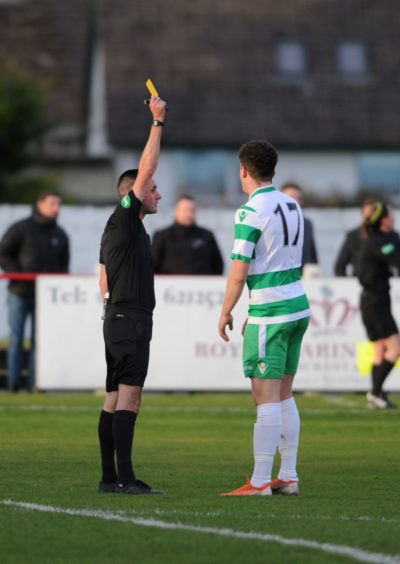 Tempers fly between Brora Mark Nicholson and Buckie's Sam Robertson resulting in a booking for Buckie  Picture by JASON HEDGES