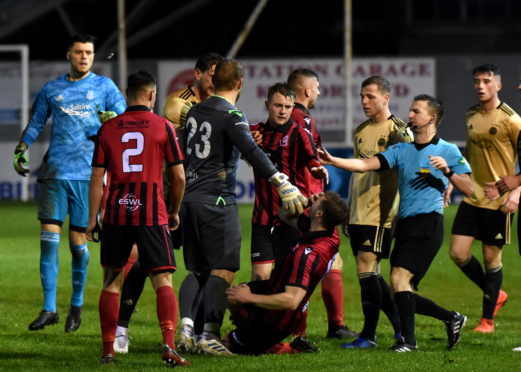 Inverurie Locos Andy Hunter falling to the ground after an altercation with Aberdeen's Ash Taylor. Picture by Kenny Elrick