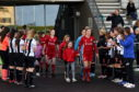 Aberdeen Women receive guard of honour from Dunfermline at ASV.  Picture by Kenny Elrick