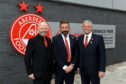 Aberdeen chairman Stewart Milne with manager Derek McInnes and vice-chairman Dave Cormack yesterday.