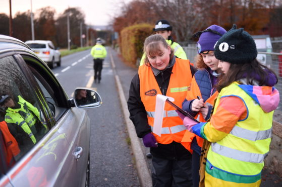 CR0016425 Police will be helping children reprimand speeding drivers outside Keig Primary School. Children interview driver who has been stopped for speeding   Picture by Paul Glendell   15/11/2019