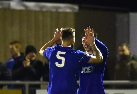 Scott Ross makes it 3-0 to Cove.  Picture by Scott Baxter