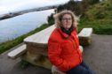 Caroline Snow, Merkinch Project Manager with one of the vandalised benches at Carnarc Point in Merkinch. Picture by Sandy McCook