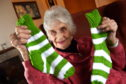 Ina Donnachie has knitted Rod Stewart a pair of socks.