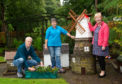 Forres in Bloom are recognised by the Queen and receive the Queen's Award for Voluntary service, the only group in Moray to win it this year. Pictured: John Marshall, Diane McGregor and Sandra Maclennan.
