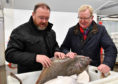 Scottish Tories leader Jackson Carlaw and Banff and Buchan candidate David Duguid inspect a freshly landed halibut during a visit to Fraserburgh fishmarket.