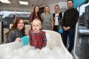LITTLE CHARLOTTE BUCHAN CAME ALONG TO PERFORM AT THE OPENING OF HER GRANDAD BILLY WALKER'S NEW KITCHEN AND BATHROOM CENTRE IN FRASERBURGH BUT FOUND THE BUBBLE BATH MUCH MORE INTERESTING.LOOKING ON ARE (L TO R ) MUM LISA,AUNTIE EMMA HAY,LINDA AND BILLY WALKER AND DAD STUART BUCHAN.