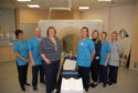 Gill Hodges (3rd from left) meets members of the Radiotherapy Department including Jacqueline Ogg (5th from left)