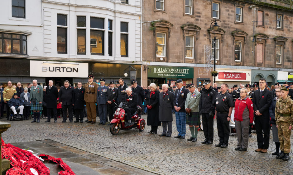 Members of the public pay their respects during the Remembrance Sunday service in Elgin
