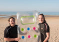 Isla and Eilidh Noble holding a lilo they used to save a man and a child.