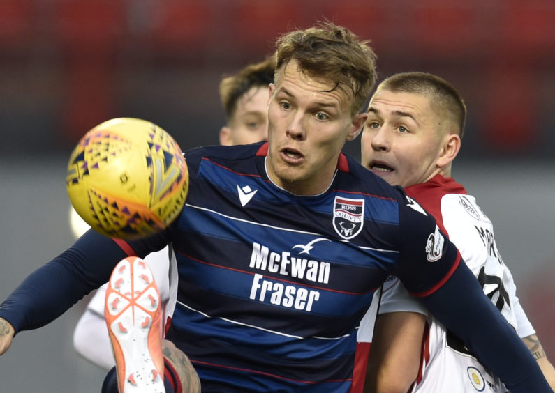 Ross County's Lee Erwin (left) competes with Scott Martin during the Ladbrokes Premiership match between Hamilton and Ross County