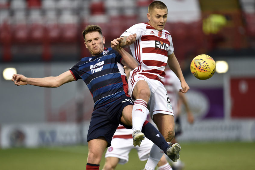 Ross County's Lewis Spence (left) competes with Scott Martin during the Ladbrokes Premiership match between Hamilton and Ross County