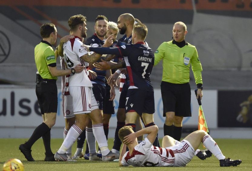 A scuffle takes place takes place between the two sides after a challenge on Lewis Smith by Richard Foster during the Ladbrokes Premiership match between Hamilton and Ross County