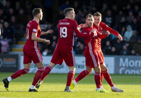 Aberdeen's Niall McGinn celebrates scoring to make it 1-1 at Ross County