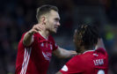 Aberdeen's Ryan Hedges (L) celebrates his goal to make it 2-1 with team mate Greg Leigh during the Ladbrokes Premiership match between Ross County and Aberdeen