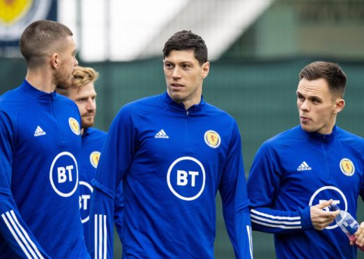 Scotland's Declan Gallagher, Scott McKenna and Lawrence Shankland during a training session