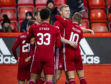 Aberdeen's Sam Cosgrove celebrates with his team-mates after scoring to make it 1-0.