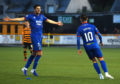 Charlie Trafford and Aaron Doran celebrate the latter's goal.