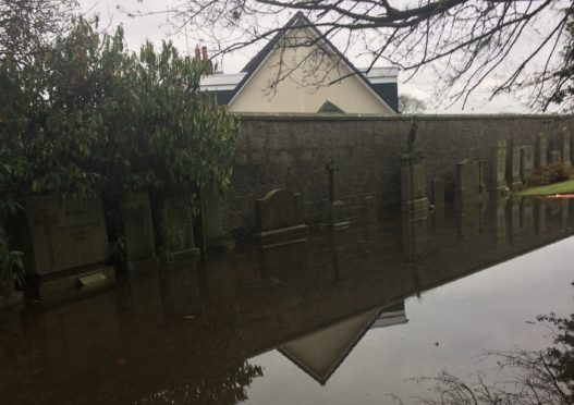 Springbank Cemetery graves flooded. Pic by Neil Drysdale.