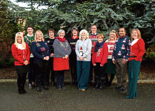 Nina Clancy (on the right) and the RSABI team in Christmas jumpers.