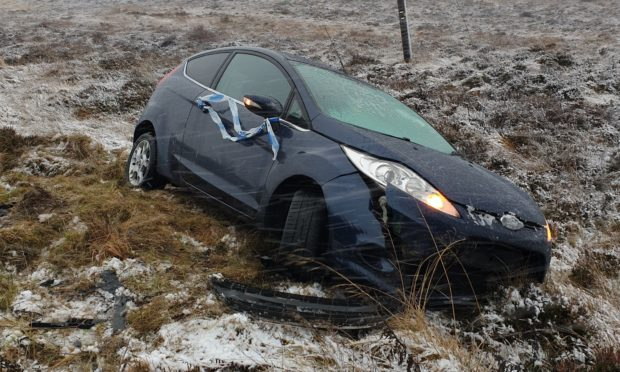 A car off the road following today's wintry conditions.
