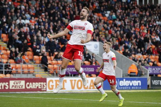 Clark Robertson celebrates his goal against Blackpool for Rotherham.