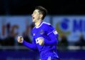 Cove's Declan Glass scores the opener then celebrates. Picture by Chris Sumner