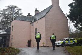 Police at the scene, where two bodies were found at a Mergie holiday cottages.