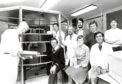 Leading the way for the revolutionary imager, Prof. John Mallard (left) with his team from the Department of Medical Physics. Left-right, back row: Hideo Toyoshima, Robert Selbie, Tom Redpath, Michael Gray and Glyn Johnson. Front, left-right: James Hutchison, Linda Eastwood and Masashi Moriwaki. 20 May 1982.