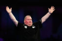 John Henderson celebrates defeating Gabriel Clemens during day nine of the William Hill World Darts Championships at Alexandra Palace, London.