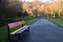 The new colourful bench in Seaton Park designed by St Machar Academy students for Langstane Housing Association. Picture by Darrell Benns.