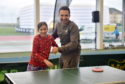 Will Bayley, professional Paralympic table tennis player, ranked world number 1 coaching some children Picture by DARRELL BENNS