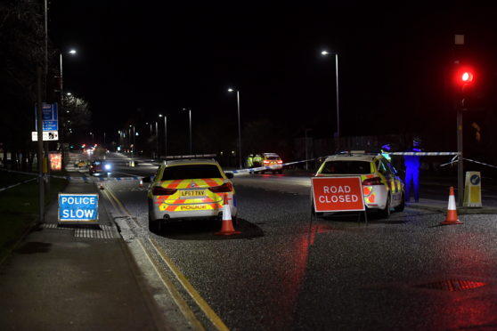 Police on site of the crash on Lang Stracht, Aberdeen.