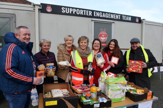 Organiser Aleen Shinnie at centre with some the other volunteers helping at the collection point  Picture by Paul Glendell