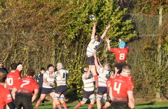 Robin Cresford gets the ball during a line out. Picture by Paul Glendell