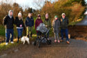 L-R: Andrew Farquhar, Nicola Farquhar, Euan Murdoch, Lynne Duncan, Helen Wilson, Sam Philip And Cliff Pirie at one of the four bridges at King Edward which was swept away in September and nothing has been done about it.