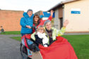 Mo Howard from Stonehaven chapter of Cycling Without Age Scotland and Christine Bell executive officer of Cycling without Age Scotland.  Seated are Ava and Doug Duffus.