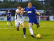 Cove Rangers defender Harry Milne (right) signed a new three-year contract yesterday.
