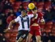 St Mirren's Jonathan Obika, left, in action with Aberdeen's Scott McKenna.