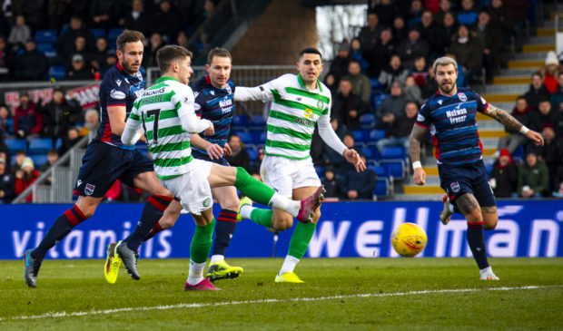 Celtic's Ryan Christie misses a penalty before scoring the rebound to make it 1-0 during the Ladbrokes Premiership match between Ross County and Celtic.