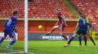 Sam Cosgrove volleys in at the back post for Aberdeen.