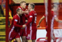 Niall McGinn, Sam Cosgrove and Lewis Ferguson celebrate the opening goal during the Ladbrokes Premiership match between Aberdeen and Hamilton Academical.