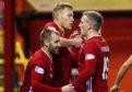 (L-R) Niall McGinn, Sam Cosgrove and Lewis Ferguson celebrate the opening goal