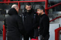 Ross County Co-managers Steven Ferguson (L) and Stuart Kettlewell chat with Motherwell Manager Stephen Robinson (R) before the Ladbrokes Premiership match between Ross County and Motherwell at the Global Energy Stadium, on December 26, 2019, in Dingwall, Scotland.